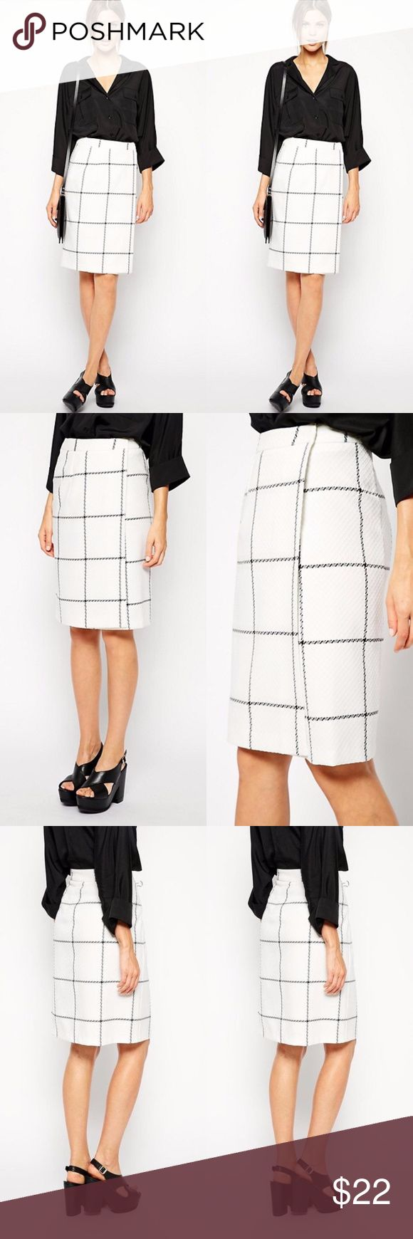 "ASOS White & Black Check Wrap Front Skirt White and Black check wrap front skirt by ASOS, knee length or longer depending on your height.  Super stylish.  Slight orange faded staining on hip (see last picture).  Measurements (taken lying flat): 23.5"" length 14"" waist 18"" hip  Materials: 81% polyester 19% viscose Lining - 100% polyester  No Trades ASOS Skirts"