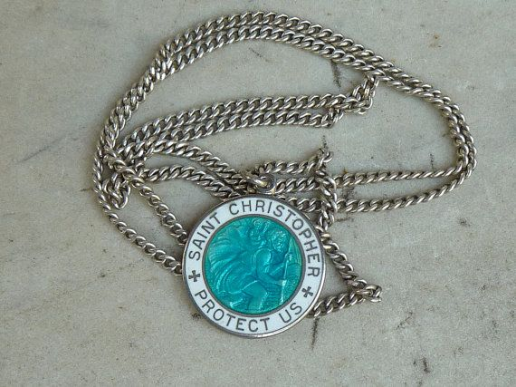 This is a classic vintage 1960's enameled Sterling St Christopher necklace with age appropriate surface wear and tarnish. Description from etsy.com. I searched for this on bing.com/images
