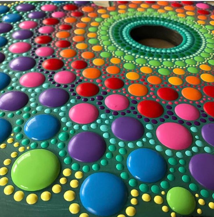 Stunning combination of colours in this bright mandala painted rock. Just beautiful.