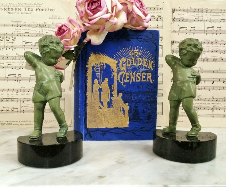 $135.95.  Where can you buy ANTIQUE FRANKART SuSPENDER BoY ArT DECO MaRBLE BaSE BOOKENDS? Here and they are Absolutely ADORABLE. These two fellers are twistin' n turnin n tryin' mighty hard to dress themselves. They got one arm around their necks trying to catch hold of their suspenders. The other is trying to pin the suspender to their shorts.  https://www.etsy.com/listing/120281782