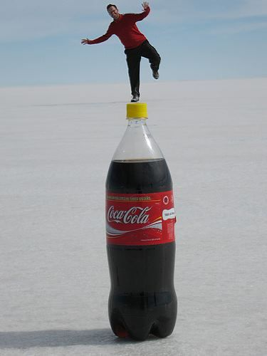 This is an example of proportion because the man is standing back a long way from the bottle but the angle is making it look as though he's standing right on top of it.