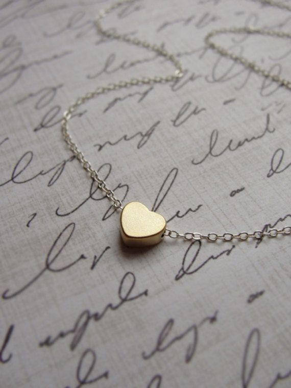 Tiny gold heart necklace silver and gold by OliveYewJewels, $25.00... someone tell my husband. Ha
