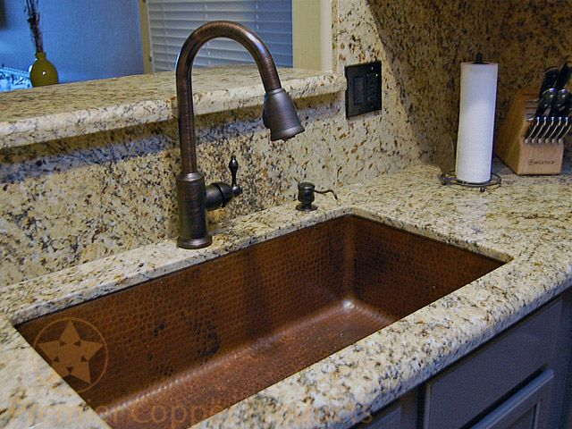 Oil Rubbed Bronze is the color of choice to pair with hammered copper kitchen sinks as seen in this beautiful kitchen.   Featured are Premier Copper Products Pulldown Kitchen Faucet and Copper Undermount Single Bowl Kitchen Sink.  Reference Model #'s K-PD01ORB and KSDB33199.