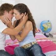Your teenager might express a romantic interest in someone. It might seem that, on one day, she was a little girl, interested in hanging out with her girlfriends. On the next day, she blushes when she mentions a certain boy's name, and you know she's just entered the throes of romantic interest.