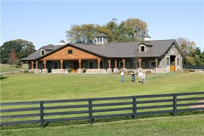 ranch style....metal building home idea w/2 car garage at end of house instead of in front!
