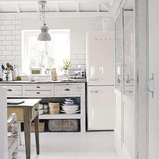 White freestanding kitchen with industrial touches - love the Roberts radio, Smeg fridge/freezer, Dualit toaster, subway tiles, etc