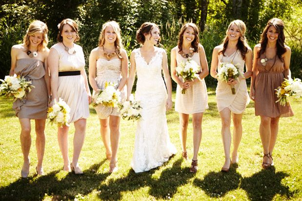 This group goes for mini dresses ranging in color from cream to mocha, making for a summery, earthy bridal party.
