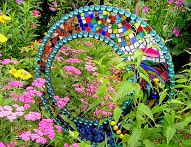 """Sue Smith Glass Mosaics and Art Glass Design - The mirror mosaics give the impression of more space and create a hint of """"The Secret Garden"""" behind."""