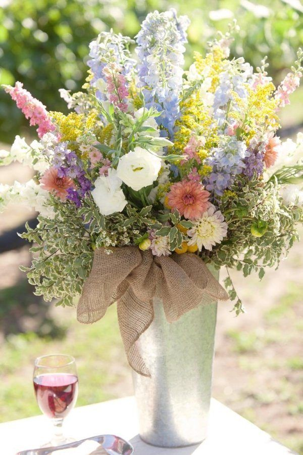 spring burlap wedding centerpiece / http://www.deerpearlflowers.com/rustic-wedding-ideas-with-burlap-touches/2/