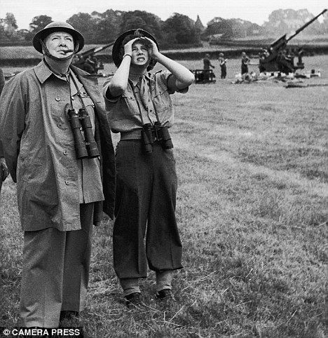 Enemy overhead: Winston Churchill and his daughter Mary scan the skies above southern England
