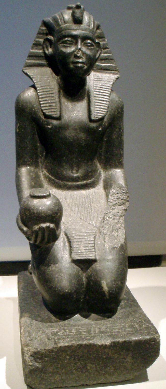 A kneeling statue depicting the pharoah Sobekhotep V (c. 1750-1700 BC) Berlin, Altes Museum