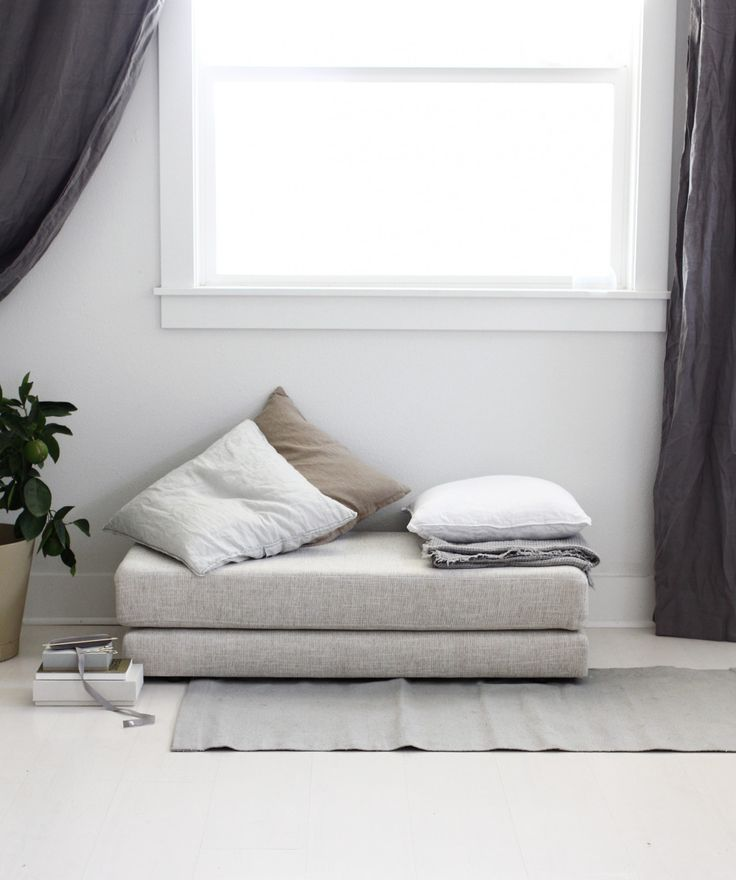 An oversized ottoman like this one doubles also as a small backless loveseat, push it against the wall and stack up cushions and throws.