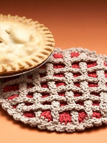 Bernat: Cherry Pie Hot Pad.  Cute idea as a gift, along with a homemade cherry pie. (Could make it apple, too!)