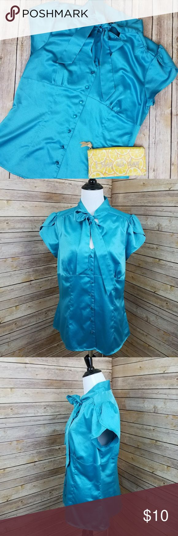 """MyMichelle Turquoise Bow Tie Neck Blouse XL MyMichelle brand Turquoise bright blue silky blend fabric button down blouse. Tulip style sleeves with satin ties at neckline into a bow. Great condition. Tagged size XL .  Measurements: Length 26"""" 18""""across front laying flat buttoned #ravenkittystyle #blouse #bowneckline #bowatneck #buttondown #professional #tulipsleeve #turquoise #blue #spring #professional #sizeXlarge #dressupordown My Michelle Tops Blouses"""