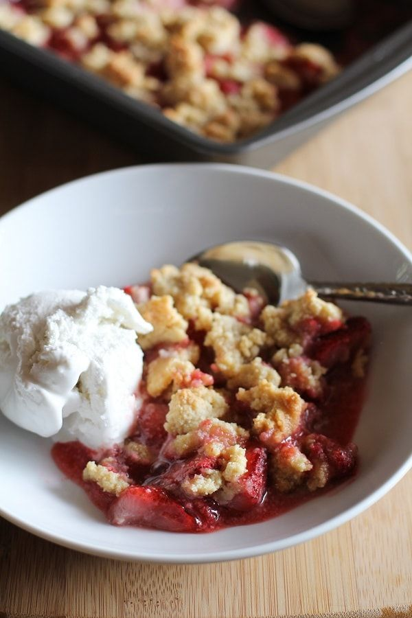 Grain-free, paleo strawberry crumble uses almond flour and the natural sweetness of summer strawberries for a dessert that is healthful and easy to make!