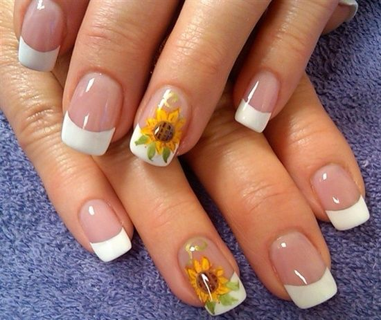 I have a personal problem with the ring finger being the one and only accent nail, but these sunflowers are very well done.