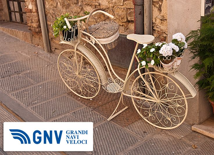 A beautiful old white #bicycle on the #street in #Italy.  Discover #GNV routes in our website: http://www.gnv.it/en/