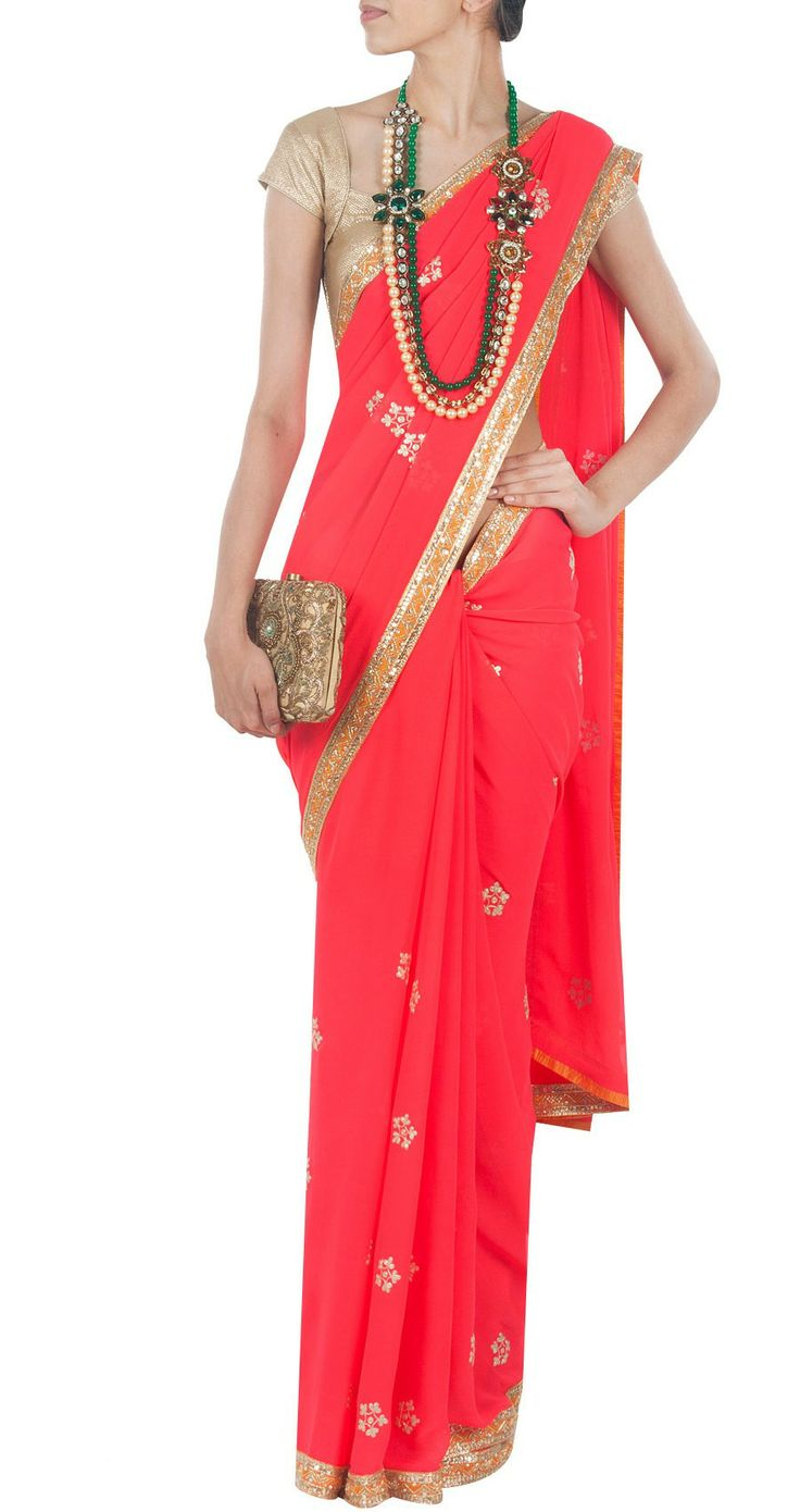 ANUSHKA KHANNA Coral embellished sari or saree teamed with a statement necklace and clutch.
