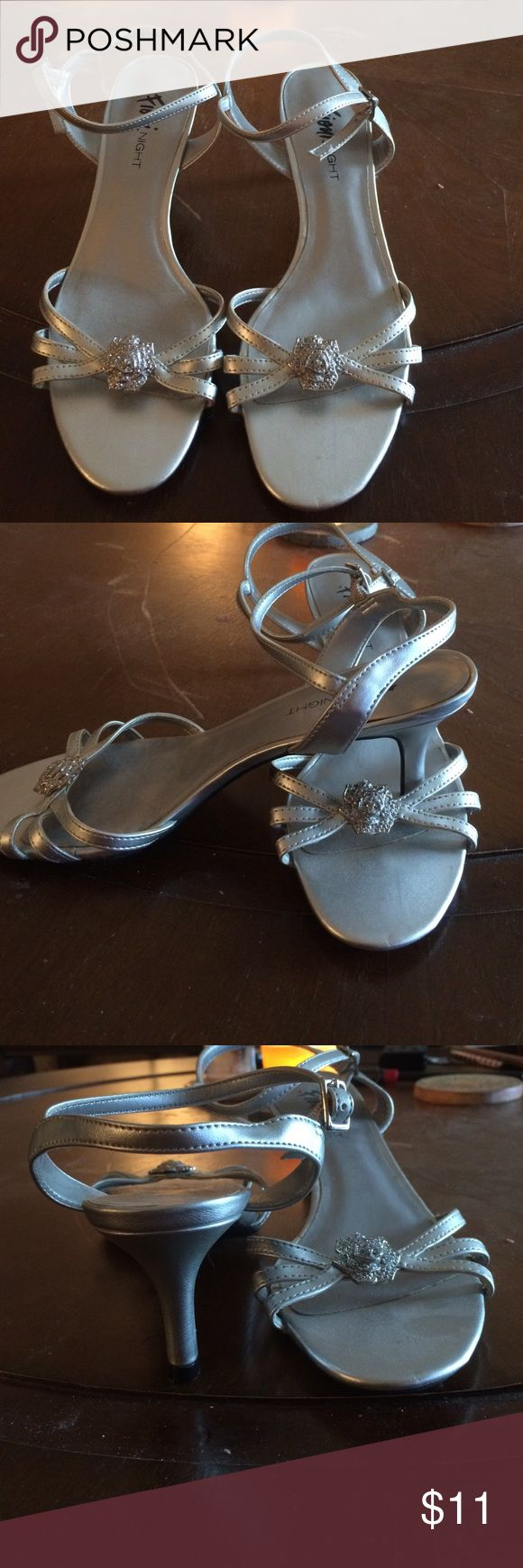 Ladies shoes Silver strappy sandals with silver flower ornament. Shoes Sandals