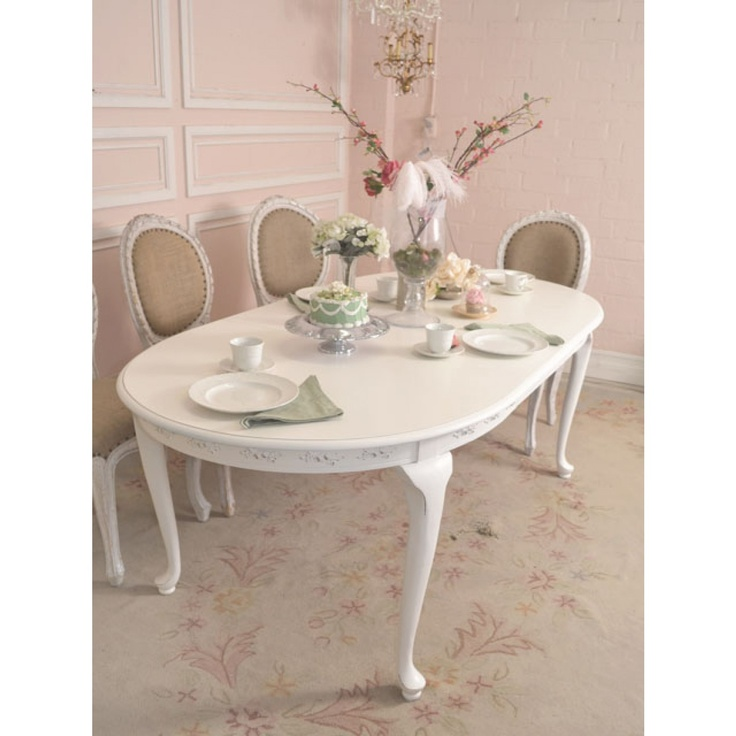 A charming, delicate piece that can suit both a small, intimate group as well as fold out for a large group of 6.