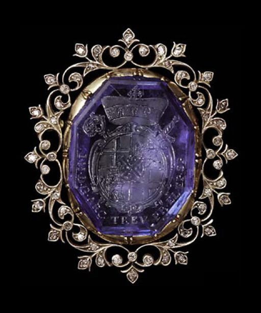 Gold, silver, and diamond brooch, set with an octagonal sapphire engraved with the arms of Johann Hugo von Orsbeck (1634-1711), appointed Archbishop Prince Elector of Trier, 13 July, and Bishop of Speyer, 16 July 1676, Abbot of Prum and Provost of Weissenburg. Now framed within a foliate border. German. Sapphire intaglio: 17th century. Setting: 19th century. Click for source and additional commentary by Diana Scarisbrick