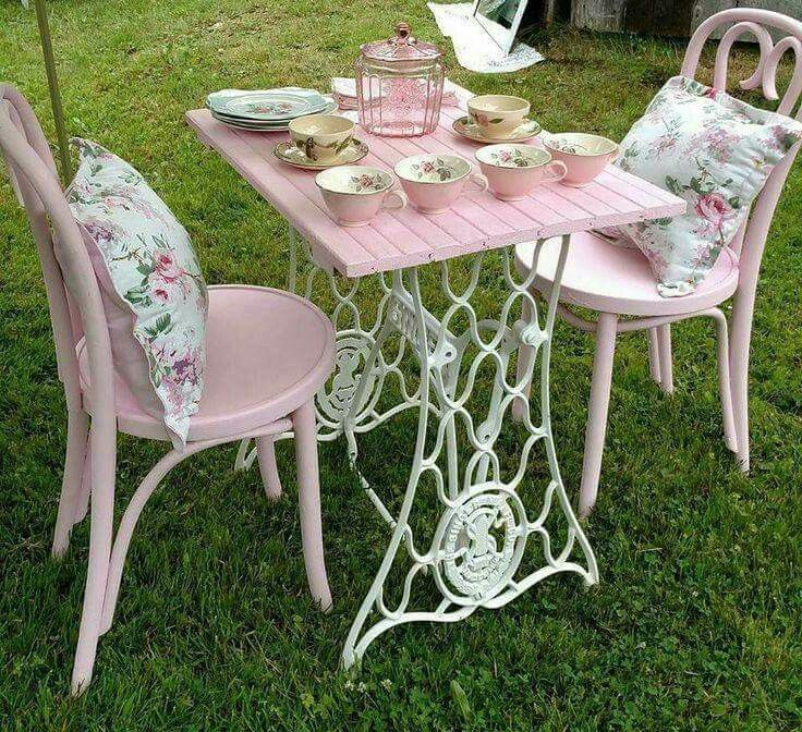 What a lovely use of an old  treadle machine  table, and a lovely shade of pink .Very chic..