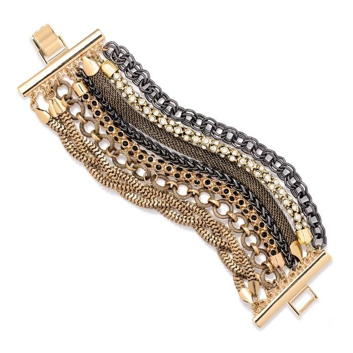 Shiny goldtone, burnished goldtone and hematite metal with clear and black rhinestones. Adjustable clasp closure.