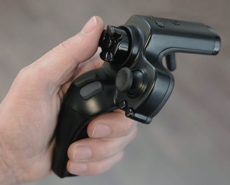 A gamepad in one hand