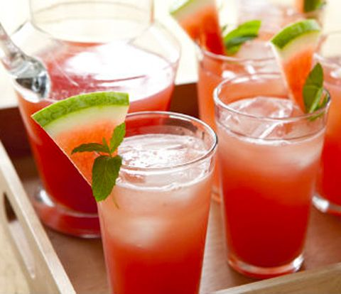 Watermelon Lemonade    6 cups 1-inch cubes seedless watermelon  1 (10 oz) bottle organic lemon juice (or same amount of juice squeezed from fresh lemons)  6 cups of water  3/4 cup sugar  crushed ice  mint sprigs, for garnish