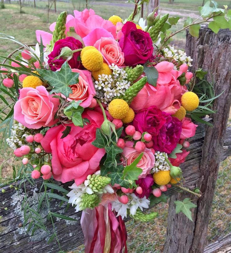 bouquet of peony, david austin roses, chins, craspedia, waxflowers and hypericum created by lovely bridal blooms