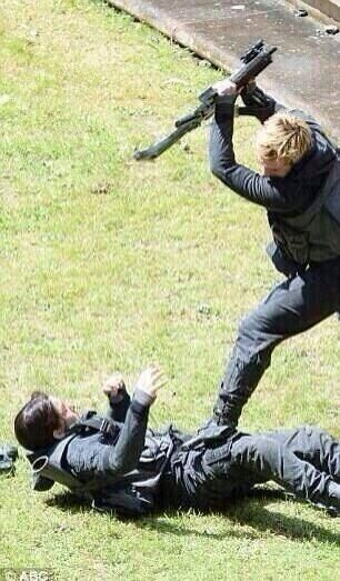 Jennifer Lawrence and Josh Hutcherson film a Hijacked Peeta scene while on the set of Mockingjay, May 14th 2014.
