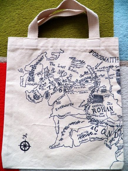 This 12 x 10.5 canvas tote bag features hand drawn maps of J.R.R. Tolkiens Middle Earth. The map continues on the tote bags front and back, including memorable locations such as The Shire, Fangorn, and Rivendell!    Every river and mountain was carefully hand drawn for any Tolkien fan