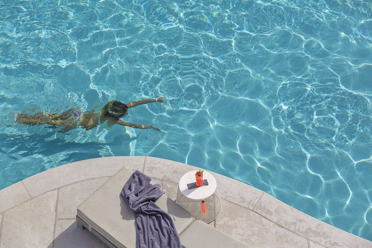 There is nothing like cooling down in the swimming pool of the Mykonos Ammos Hotel on a hot summer day. After my swim, I like enjoying a tasty cocktail on my sun bed. I am counting the days until I can do this again! #MykonosAmmosHotel #Mykonos #OrnosBeach #HotelInMykonos #MykonosHotel #Ornos #MykonosAmmos #pool #SwimmingPool #Girl #Woman #Diving #Swimming #Cyclades #Greece #Summer