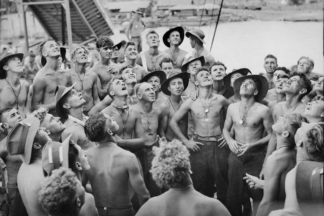 Happy Anzac day!  Servicemen played Two-up aboard the troop ship 'Cape Alexander' in Lae, New Guinea, in November 1944. It's a simple game: Two coins are placed tails up and marked with a white cross. They are placed on a kip—a small, flat piece of wood with a handle—and sent up into the air.