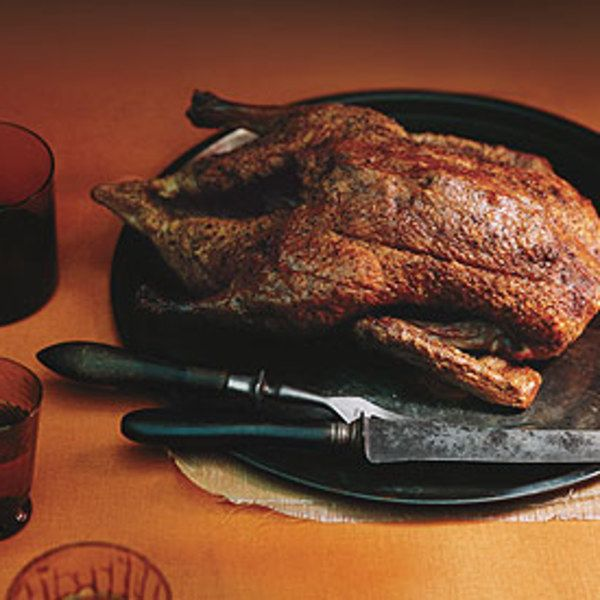 A whole roasted duck doesn't have to be fussy. With just a few hours' roasting          and hardly any work at all, you can have a juicy bird with crisp skin—the best of both textures. This duck is delicious with the plum applesauce.