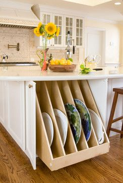 A brilliant idea for storing those over-sized platters that never seem to be accessible.  From Kitchens by Meyer, Inc.