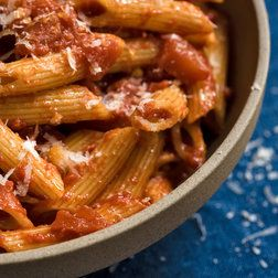 NYT Cooking: This, Mario Batali wrote in 2013 in The Times, is one of his late-night favorites. Its uncomplicated nature lends itself to an after-midnight feast. It's basically pasta with tomato sauce and cheese, but red pepper flakes give the sauce a delicious kick.