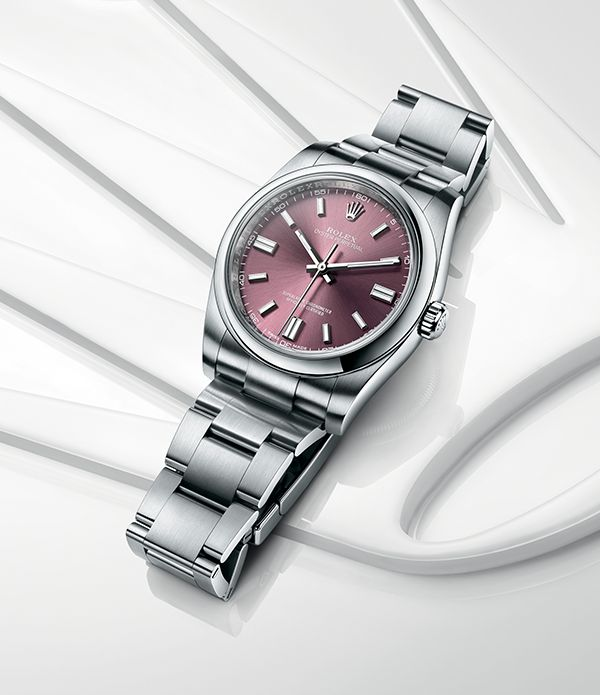 Rolex Oyster Perpetual 36 in 904L steel with a red grape dial and Oyster bracelet.