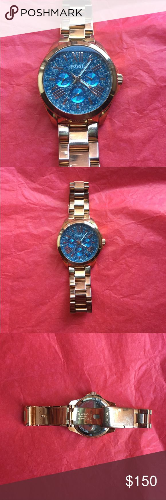 Blue💎 diamond studded Fossil watch 💎 Gorgeous Blue diamond studded Fossil watch! Selling it only because I just bought a new one. It is beautiful! Has the date, weekday, and military time! A few scratches can see in pics as it has been well loved! An amazing watch - make an offer! I always get compliments on it💋💎💎💎 Fossil Accessories Watches