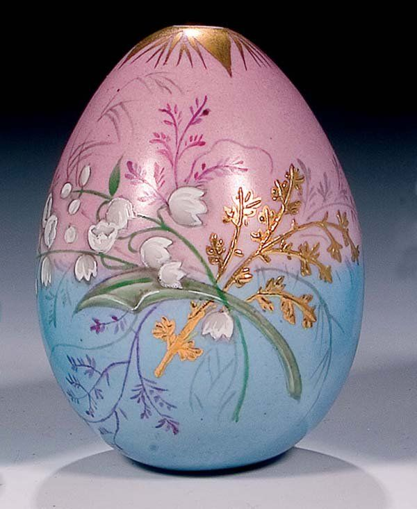 "A porcelain egg painted with lilies of the valley and with the gilt inscription ""Khristos Voskress"". Russia, end of 19th century. 9,5 cm high.."