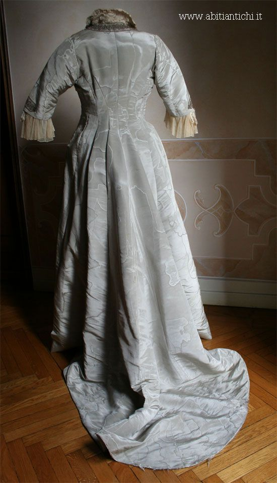 """Negligee whole, for the house of 1888,of silk in powder blue. Collar of lace stiffened by  iron wire . Labeled """"L. Tompkins - South Kensington"""""""