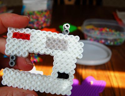 perler beads. I wish one of my grandkids would make me a perler bead sewing machine. Too cute.