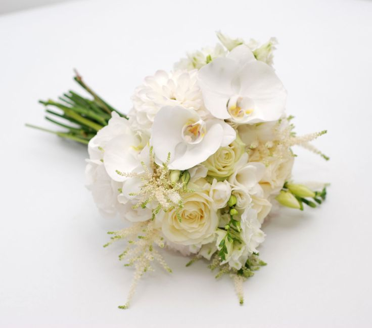 All white bridal bouquet with elegant phalaenopsis orchids