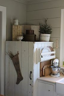 there's a fridge behind there!!  Picture a shaker cabinet around the fridge.  So hard to find a balance between restoration and authenticity and getting too cutesy in hiding the 21st century.  This particular coverup hit the mark I think.  I think a shaker version would too from:  1871farmhouse.blo...