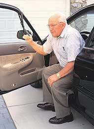 Portable handle Car Caddie wraps around a door frame for ease getting out of the car.  google car caddie about $20