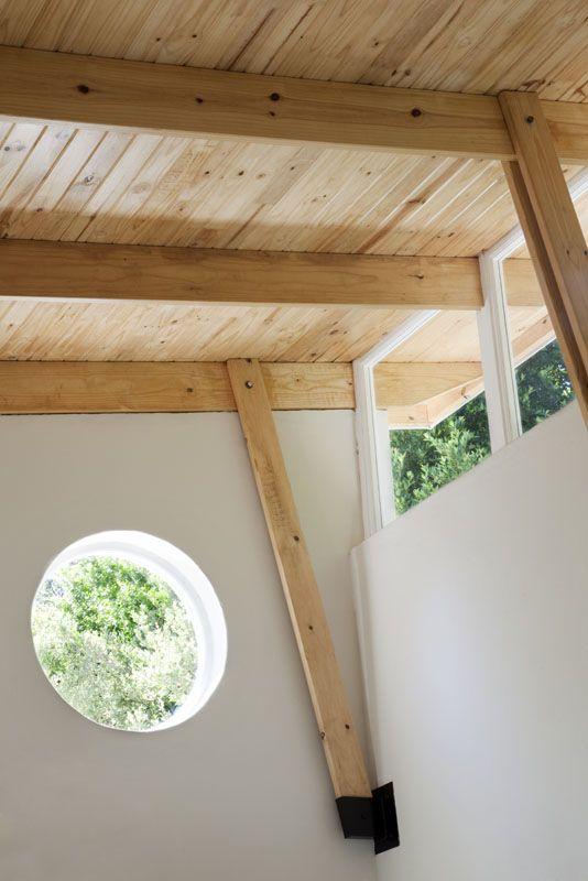 clerestory round window exposed truss yoga studio
