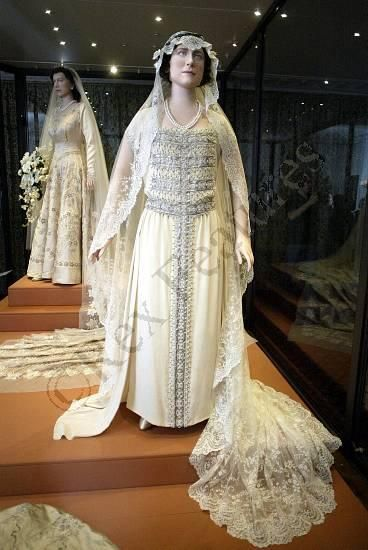 Queen Elizabeth the Queen Mother's wedding gown at Kensington Palace.  HM the Queen's 1947 gown in the background.