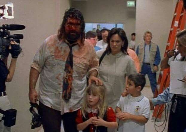Classic image of WWE Hall of Fame legend Mick Foley, with his wife Collette, daughter Noelle, and his son Dewey from 1998 WWE Royal Rumble. Foley and his family were featured in the documentary Beyond The Mat, showcasing the harsh reality of the wrestling business.