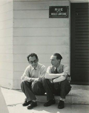 Man Ray and Marcel Duchamp Seated on a Curb, 1949, gelatin silver print. Francis M. Naumann Fine Art, New York. (via:)