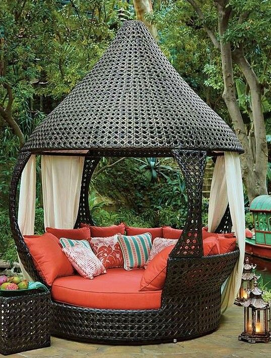 Looks great outdoor furniture, red cushions and roof